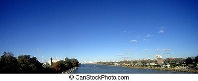 Panoramic photo of the Guadalquivir river. The capital city Sevilla. Spain.