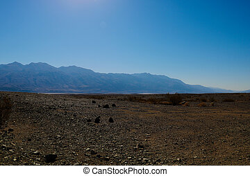 Panoramic red rocky view on Death Valley from Hell's Gate - California.