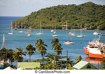 panoramic rooftop view of cruise ships houses stores Port Elizabeth harbor Bequia St. Vincent and the Grenadines