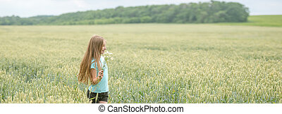 Panoramic shot of a girl in a field