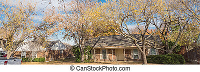 Panoramic single story bungalow houses in suburbs of Dallas with bright fall foliage colors