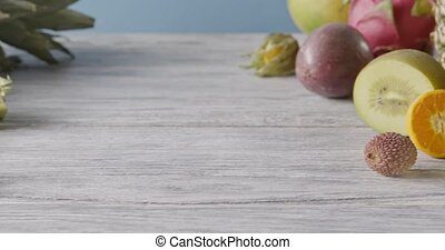 Panoramic slow motion of tropic fruits - pineapple, coconut,...