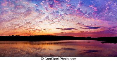 panoramic sunset above the lake with bright colors go very...