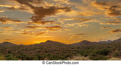 Panoramic sunset over a mountain landscape in the Sonoran Desert