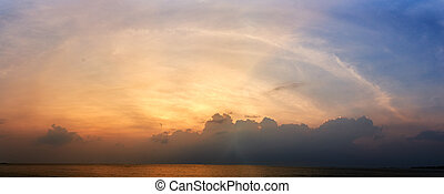 Panoramic sunset with fluffy clouds in the twilight sky, Sunlight with dramatic cloud over sea