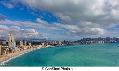Panoramic time lapse view of Benidorm with high buildings, mountains and sea