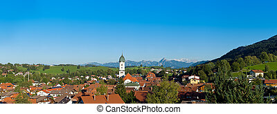 Panoramic view above the roofs of Pfronten im Allgaeu, Alps...