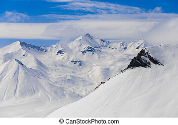 Panoramic view at snowy mountains