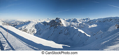 Panoramic view down snow covered valley in alpine mountain range
