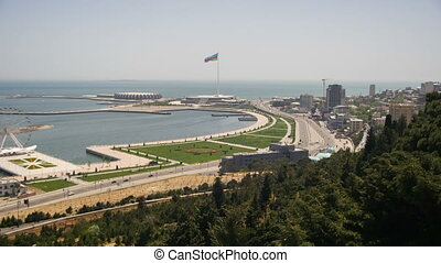 Panoramic view from above on a big city near the sea. Baku, Azerbaijan. Time Lapse