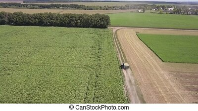 Panoramic view from drone above farming lands with moving ...