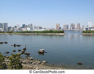 Panoramic view from Odaiba island to Tokyo skyscrapers on the coast of Tokyo Bay, Japan.