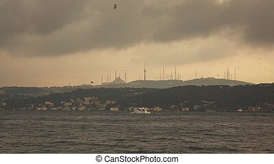 Panoramic view from sea to bank with sityscape with Mosque Istanbul Turkey on a sunset, at the summer. 4K UHD video, 3840, 2160p.