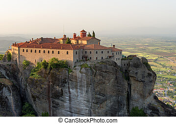 Panoramic view in a spring sunny day of Agios Stefanos St Stefan Monastery Meteora monastery on the high cliff rock, Greece