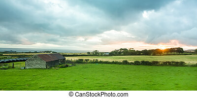 Panoramic view of a barn and sunrise