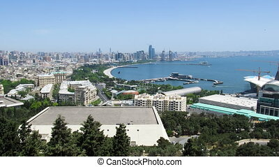 Panoramic View of a Big City Megalopolis by the Sea at Summer Day. Baku, Azerbaijan. Time Lapse