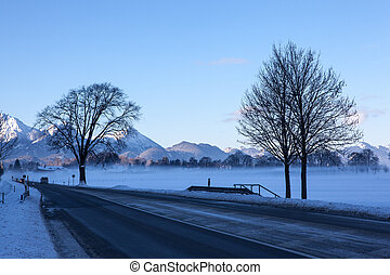 Panoramic view of a scenic winter road in the Bavarian Alps