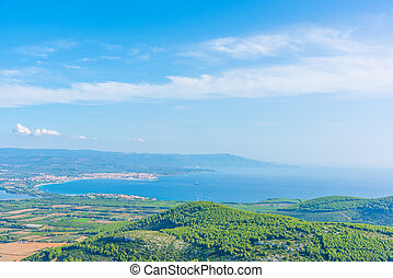 Panoramic view of Alghero coastline on a sunny day
