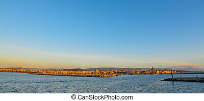 panoramic view of Alghero under a blue sky