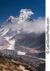 Panoramic view of Ama Dablam peak and himalaya village