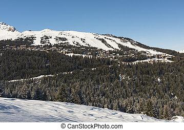 Panoramic view of an alpine mountain village ski resort