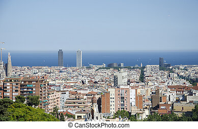 Panoramic view of Barcelona from Park Guell in a summer day in Spain. Top view of picturesque Barcelona cityscape in sunny day.