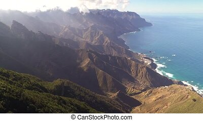 panoramic view of beautiful mountains near ocean shore from...