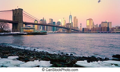 Brooklyn bridge and Manhattan at sunrise - Panoramic view of...