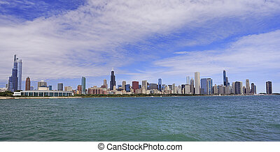 Panoramic view of Chicago skyline with Lake Michigan on the foreground,