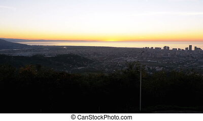 Panoramic view of evening Batumi at sunset from above from...