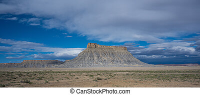 Panoramic view of Factory Butte on a cloudy morning