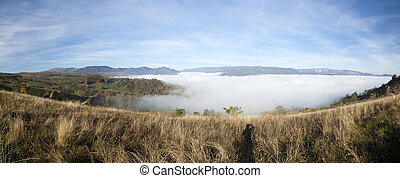 Panoramic view of foggy morning in the mountains