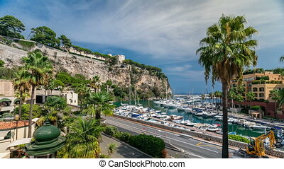 Panoramic view of Fontvieille timelapse - new district of Monaco. Boats, yachts in harbor and a high-rise apartment complex. Principality of Monaco is a sovereign city state, located on the French Riviera in Western Europe.
