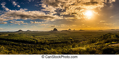 Panoramic view of Glass House Mountains at sunset visible from Wild Horse Mountain Lookout