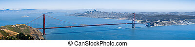 Panoramic view of Golden Gate Bridge; the San Francisco skyline visible in the background; California