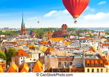 Panoramic view of historical buildings and roofs in Polish medieval town Torun