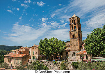 Panoramic view of houses, church and belfry in the village of Moustiers-Sainte-Marie.