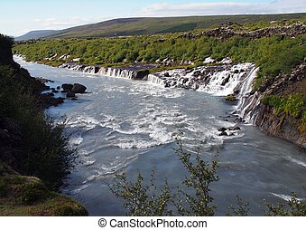 Panoramic view of Hraunfossar waterfall in Iceland