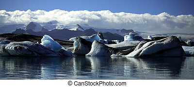 Panoramic view of icebergs and glaciers - Icebergs and...