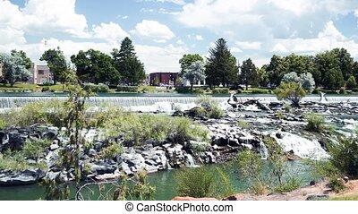 Panoramic view of Idaho Falls Waterfalls on a beautiful summer day. Slow Motion