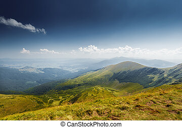 Panoramic view of idyllic mountain scenery in the Alps with...