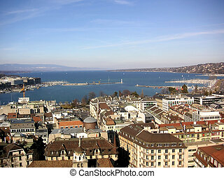 Panoramic view of Lake Geneva, with the lighthouse and the Alps in the background