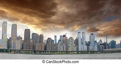 Panoramic view of Manhattan East Side with cloudy sky
