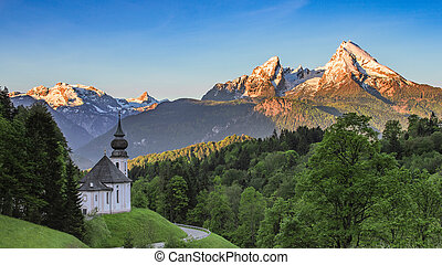 Panoramic view of Maria Gern church with snow-capped summit...
