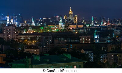 Panoramic view of Moscow timelapse - Kremlin towers, State general store, Stalin skyscraper, residential building at night