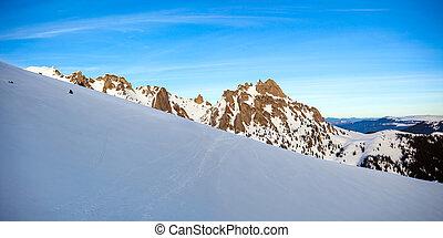 Panoramic view of Mount Ciucas peak at a sunset on winter