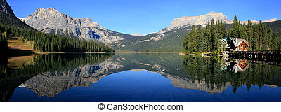 Panoramic view of mountains reflected in Emerald Lake, Yoho...