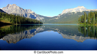 Panoramic view of mountains reflected in Emerald Lake, Yoho National Park, British Columbia, Canada