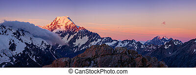 Panoramic view of Mt Cook mountain range at colorful sunset, NZ