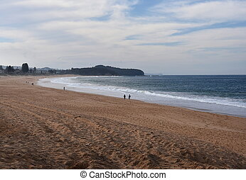 Panoramic view of Narrabeen beach on a cloudy day